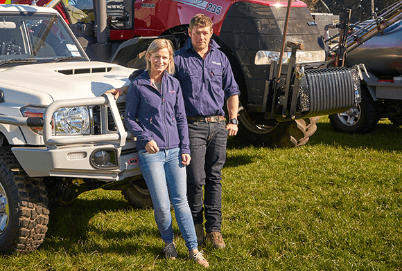Kane and Shelley Walsh from Walsh Contracting Limited Te Anau with some of their vehicles, a red tractor and white truck