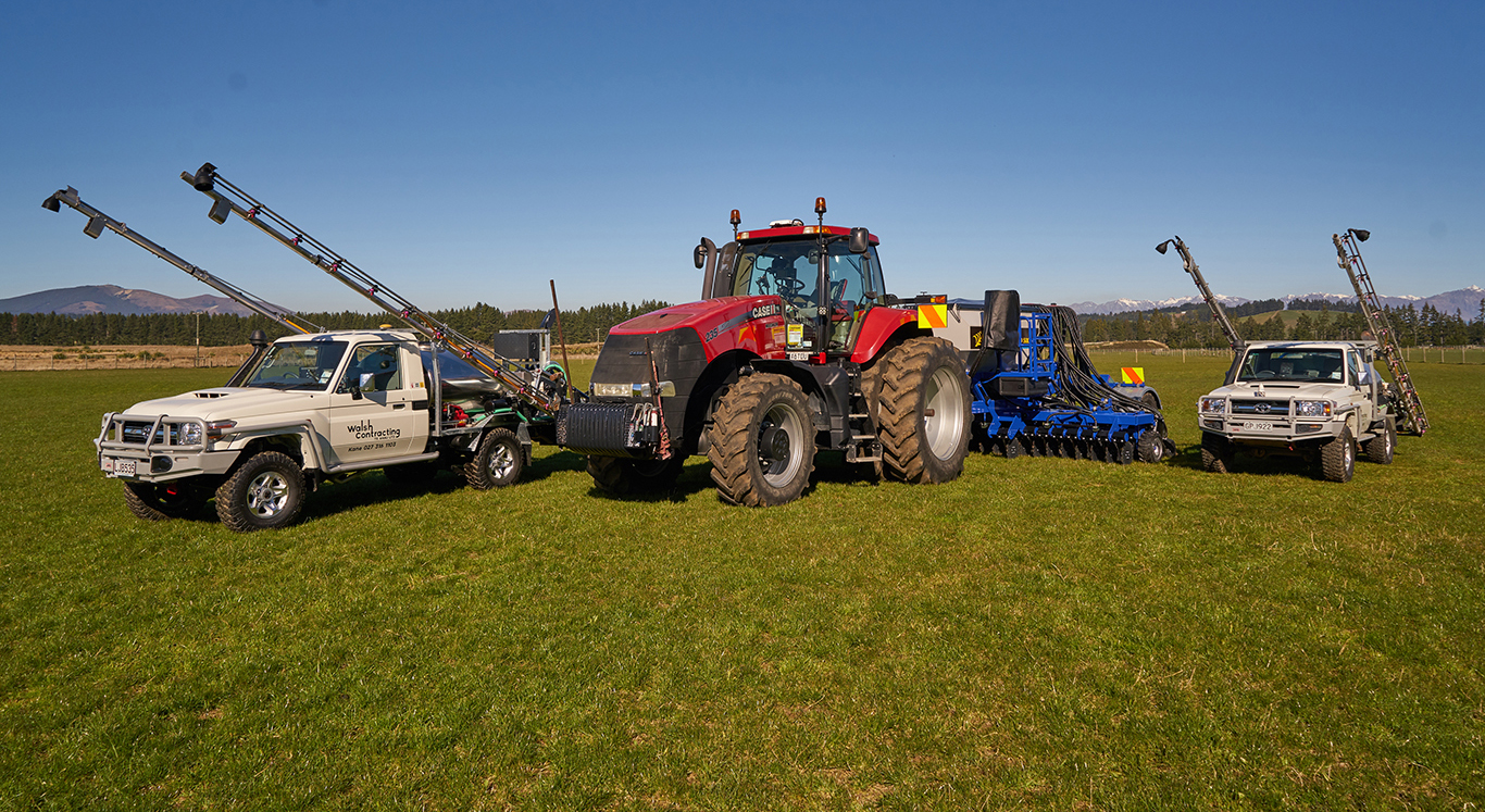 Agricultural contracting vehicles belonging to Walsh Contracting including tractor and two trucks
