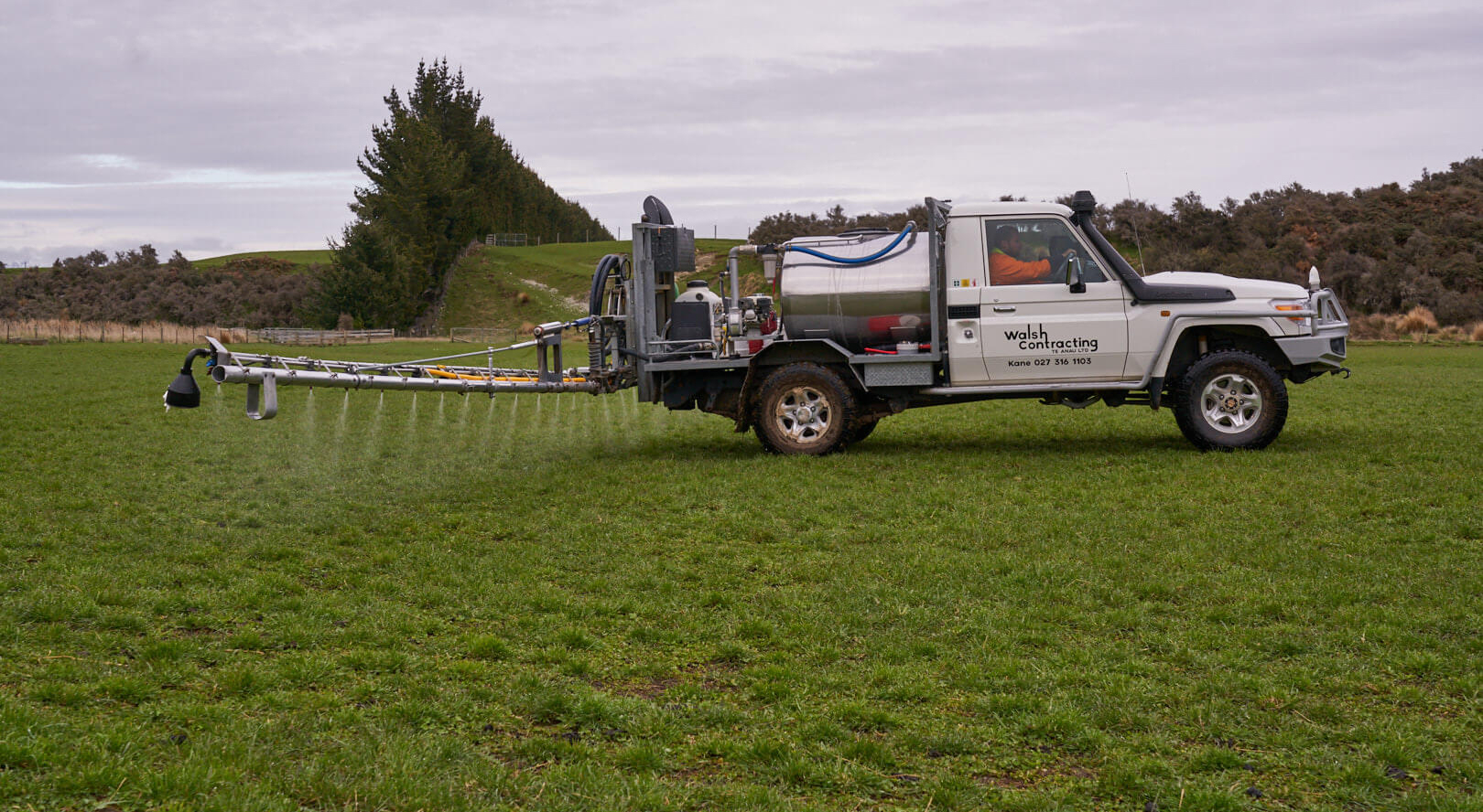 Walsh Contracting Truck spraying paddock with controlled booms