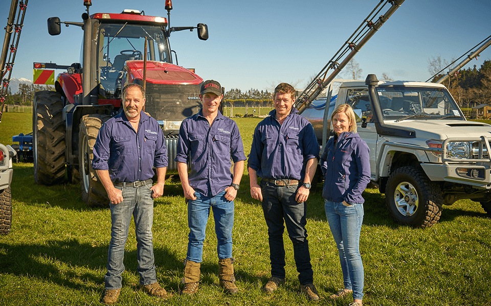 Walsh Contracting Team photo with agricultural contracting machinery in the background.